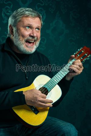 studio portrait of senior man with