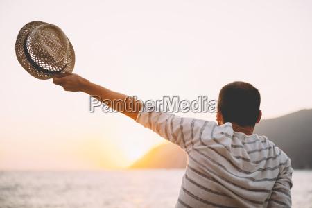greece cylcades islands amorgos man holding