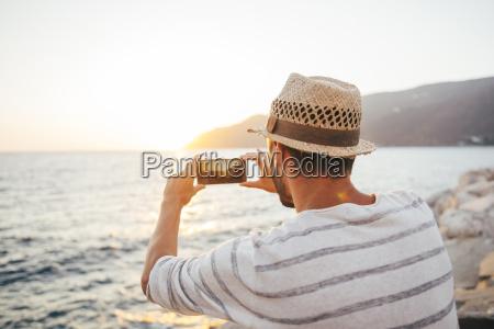 greece cylcades islands amorgos man taking