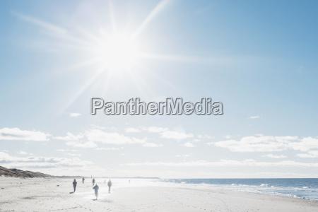 denmark hirtshals people walking on beach