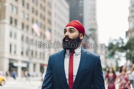 indian businessman crossing street in manhattan