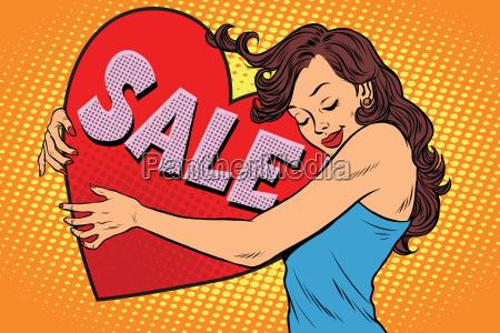 bella giovane donna abbracciando vendita cuore