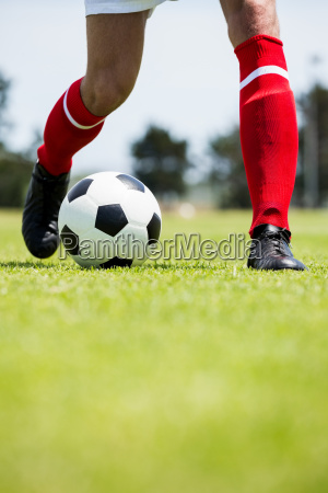 football player practicing soccer