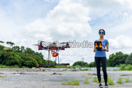 woman control the drone flying