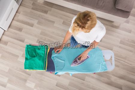 high angle view of woman ironing