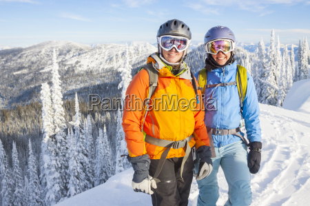 two female backcountry skiers on snowy