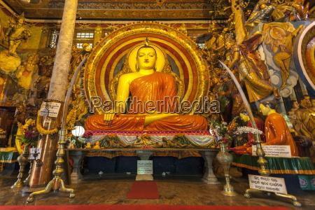 large buddhist statue at gangaramaya temple