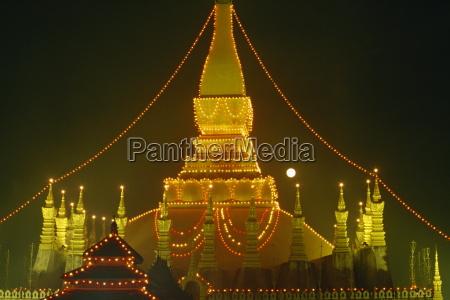 lights illuminate the great stupa of