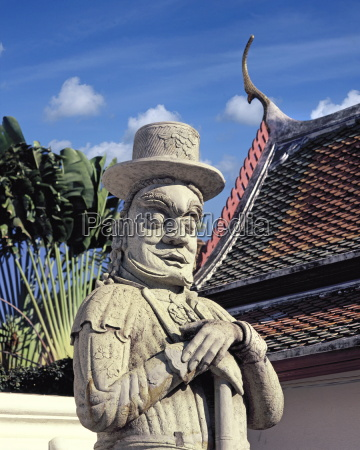 guardian figure with european hat at
