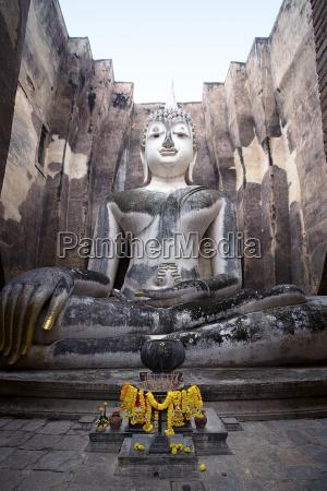 a giant sukhothai era sitting buddha