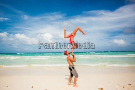 acrobatic couple balancing together on the