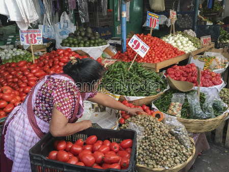 woman selling produce at a traditional