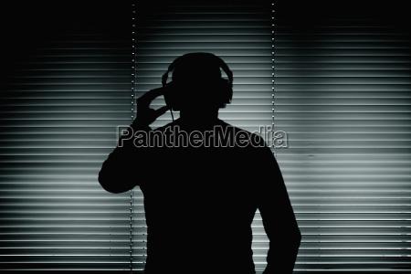 comunicazione spia minaccia in piedi fotografia
