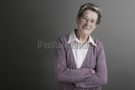 portrait of senior woman standing with