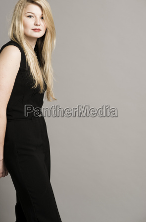 portrait of blond woman standing in