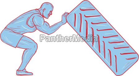 fitness athlete pushing back tire workout