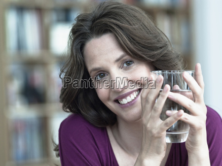 germany hamburg woman holding glass of