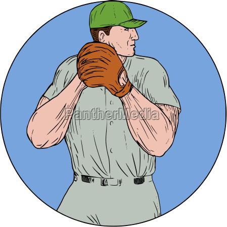 baseball pitcher starting to throw ball