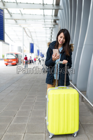 asian woman go travel and using