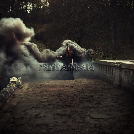 woman walking on the bridge in