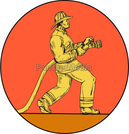 fireman firefighter holding fire hose circle