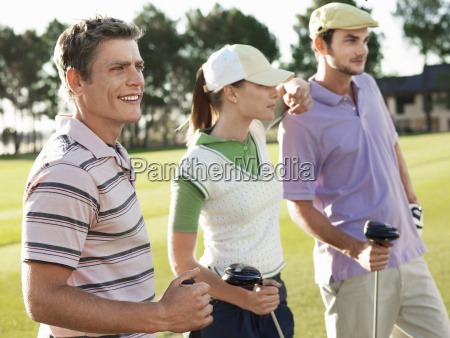 golfers standing on golf course