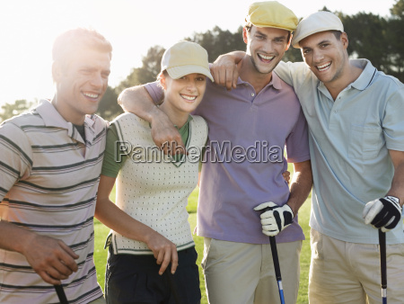 cheerful golfers on golf course
