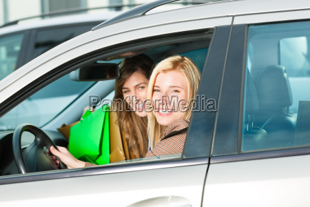 two women were shopping and driving