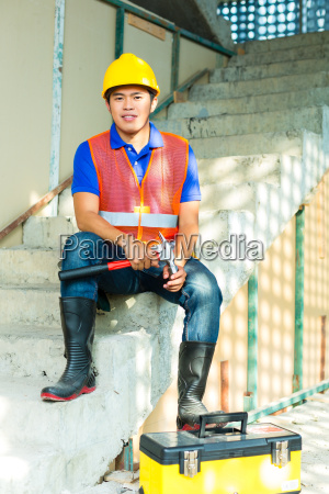 asian indonesian construction worker on building