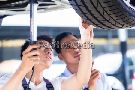 car mechanic and customer in asian