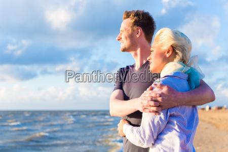 couple enjoying romantic sunset on beach