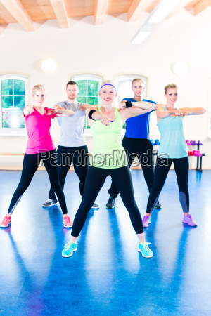 group of fitness people in gym