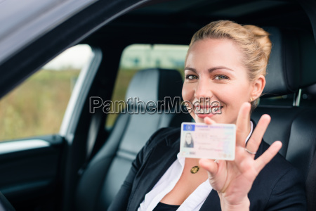 woman showing her driving license out