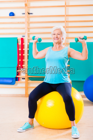 senior woman doing fitness sport in