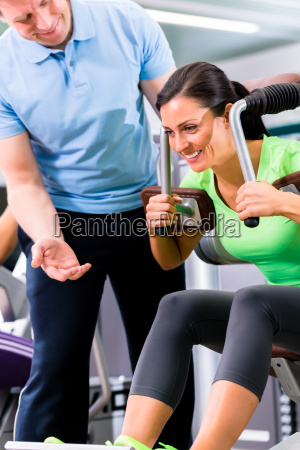 woman with personal trainer doing sport
