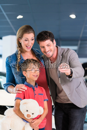 family showing key to newly bought