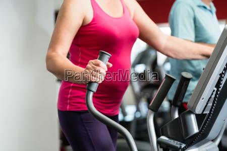 elderly woman training on cross trainer