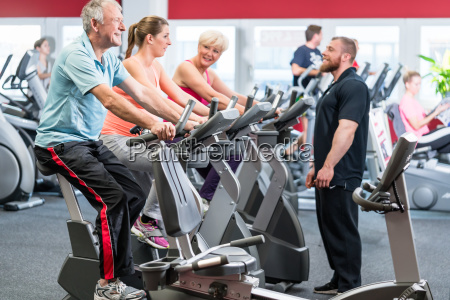 group spinning with personal trainer in