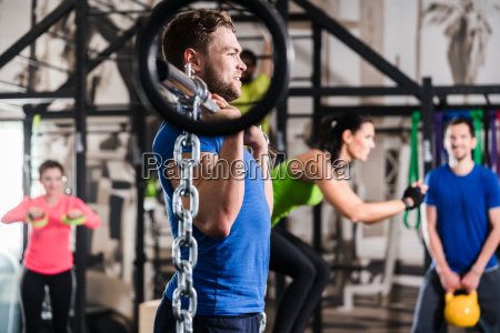 man lifting dumbbell in functional training