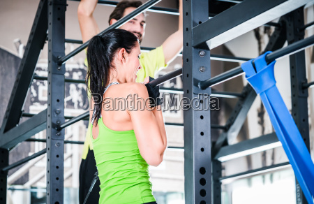 women and man training in cage