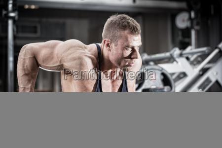man in gym at dip exercise