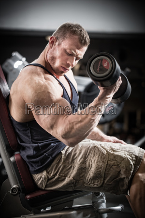 man at fitness training with dumbbells