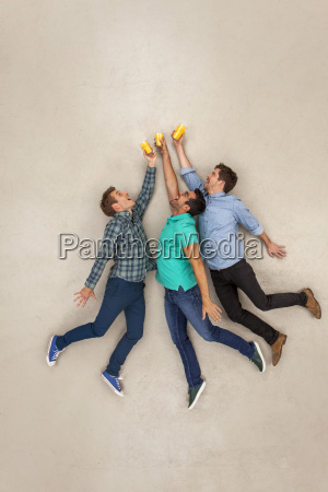 friends jumping and clinking glasses