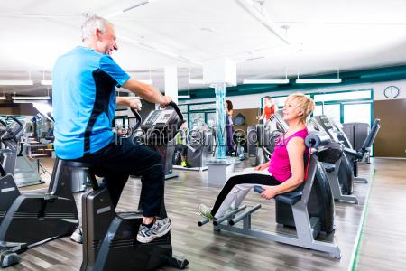seniors sport exercising in gym in