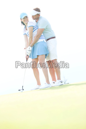 low angle view of couple playing
