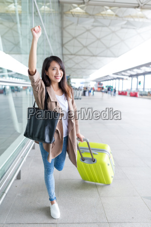 excited woman go travel