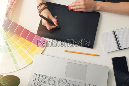 graphic designer using digital drawing tablet