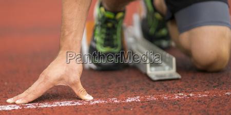 mano dettaglio piede atletica leggera velocista