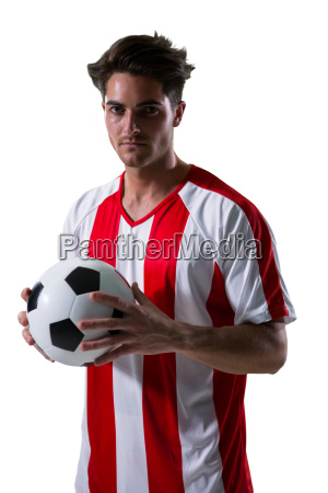 football player holding football with both