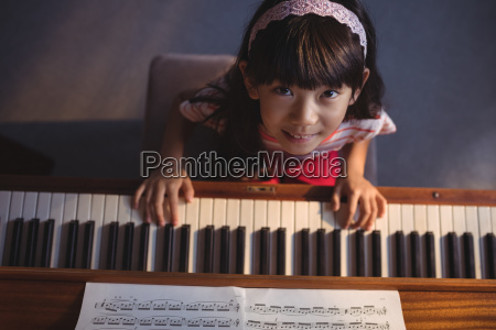 overhead portrait of girl playing piano